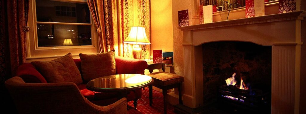 The Quayside Hotel in Brixham - Lounge fireplace
